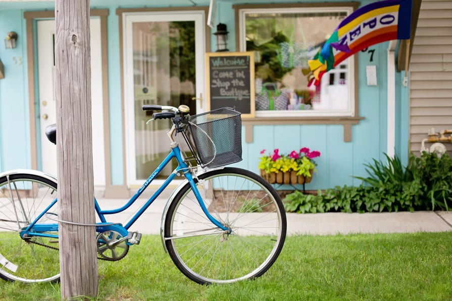 Bicycle in front of a blue store front