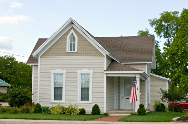 Two story home in Canton Michigan with an American flag near the front porch.